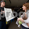 "Curtis Clegg - cclegg@shawsuburban.com<br /> <br /> Self-proclaimed ""libertarian activist"" Ted McCarron of DeKalb (left) and Gina Crosley-Corcoran of Lombard get into a heated discussion about the legalities of breast feeding in public places in front of the No Strings Attached resale shop in DeKalb on Thursday, June 2, 2011.  Crosley-Corcoran is breast feeding her six week-old daughter Jolene on the sidewalk in protest of an incident on Tuesday where DeKalb resident Nichole Eidsmoe was reportedly asked not to breast feed her daughter in the shop."