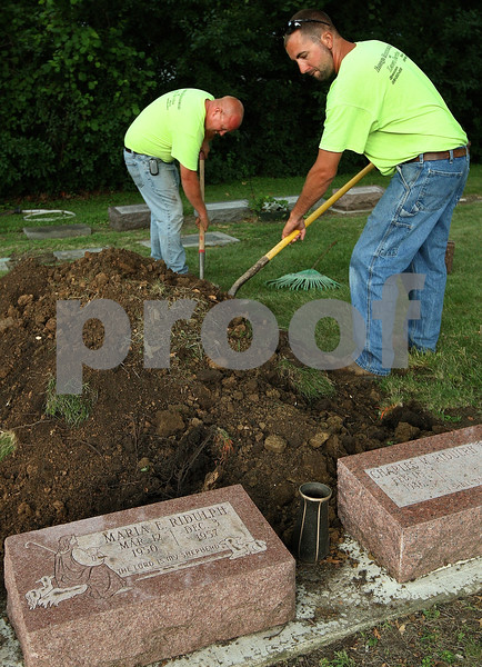 Kyle Bursaw – kbursaw@daily-chronicle.com<br /> <br /> After exhuming the grave of Maria Ridulph, Elmwood cemetery employees Lenny Reynolds Jr. (right) and Josh Goad clean up the area around Ridulph's grave around 8:45 a.m. on Wednesday, July 27, 2011.