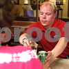 Kyle Bursaw – kbursaw@daily-chronicle.com<br /> <br /> Jason Wright, ticket sales manager for the Liners, serves beverages during a banquet for Liners players to meet their host families in Sycamore, Ill. on Tuesday, May 31, 2011.