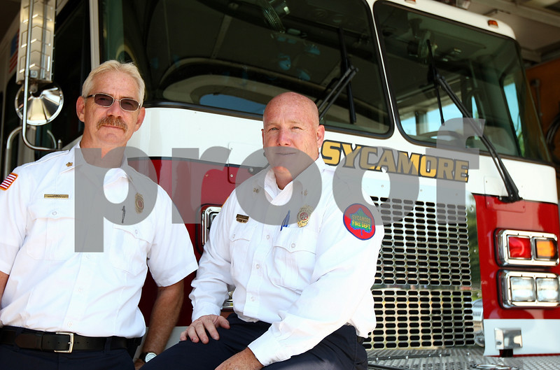 Kyle Bursaw – kbursaw@shawmedia.com<br /> <br /> Sycamore Fire Chief Mark Kessler (left) and Assistant Chief Marc Doty were two of the firefighters from Sycamore that traveled to New York in 2001 after the events of Sept. 11.