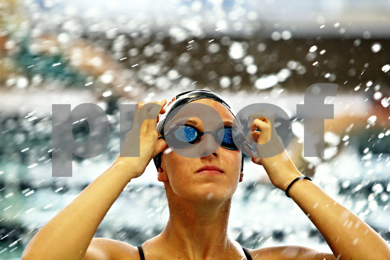 Rob Winner – rwinner@shawmedia.com<br /> <br /> Tara Gidaszewski puts on her goggles during swim practice at Huntley Middle School on Thursday, Nov. 10, 2011.