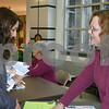 Christopher Brinckerhoff – cbrinckerhoff@daily-chronicle.com<br /> <br /> Lisa March (right), director of continuing education at Kishwaukee College, shares some information about the veterinary assistant program with Marelyn Cossyleom, senior at Sycamore High School, at the college's open house Feb. 21. The veterinary assistant program is new to Kishwaukee College this year, and is one of 12 non-credit, short term programs, according to March.