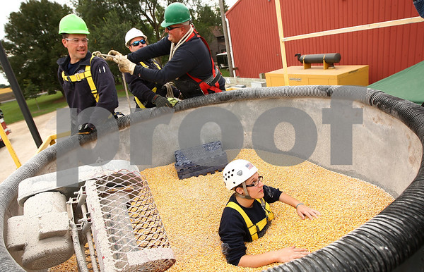 Kyle Bursaw – kbursaw@shawmedia.com<br /> <br /> Firefighters prepare to rescue paramedic Sarie Turner (in corn) during a training exercise at a farm in Sycamore, Ill. on Saturday, Sept. 24, 2011.