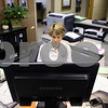 Kyle Bursaw – kbursaw@shawmedia.com<br /> <br /> Penny Meier works on inputting records data into the computer system at the DeKalb Police Department on Monday, Oct. 31, 2011, something that was added to her other responsibilities since the police department reduced staffing.