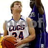 Rob Winner – rwinner@daily-chronicle.com<br /> <br /> Genoa-Kingston's Robert Thurlby looks to shoot while Joseph Jones of Plano defends during the first quarter of the IHSA Class 2A Plano Regional Semifinal in Plano, Ill., on Wednesday, February 23, 2011.