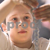 Kyle Bursaw – kbursaw@daily-chronicle.com<br /> <br /> Nathan Zimbelman, 9, stacks a series of nuts on a magnetic plate. The display was at a table promoting the NIU summer science camps, part of the 2011 Illinois Junior Academy of Science – Northern Region V Science Fair Regional Project Session Semi-Finals in the Holmes Student Center at NIU on Saturday, March 12, 2011.