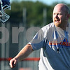 Kyle Bursaw – kbursaw@daily-chronicle.com<br /> <br /> Genoa-Kingston head coach Travis Frederick talks to one of his players before a chase and tackle drill during practice on Thursday, Aug. 11, 2011.