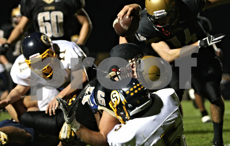 Rob Winner – rwinner@shawmedia.com<br /> <br /> Sycamore quarterback Ryan Bartels (6) is tackled near the goal line during the second quarter in Sycamore, Ill., on Friday, Sept. 23, 2011.