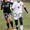 Rob Winner – rwinner@daily-chronicle.com<br /> <br /> Kaneland's Delaney Stryzek (13) chases after Indian Creek's Cameron Wallace (9) during the first half on Monday, April 4, 2011, in Waterman, Ill. Kaneland defeated Indian Creek, 5-0.