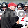 Kyle Bursaw – kbursaw@daily-chronicle.com<br /> <br /> Offensive line coach Rod Carey talks to his players during practice at Huskie Stadium on Saturday, March 26, 2011.