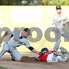 Rob Winner – rwinner@daily-chronicle.com<br /> <br /> Lorain County's James DiBiasio (left) tags out DeKalb County's Brady Renner during a steal attempt in the first inning of their game in Sycamore, Ill. on Thursday, July 21, 2011.