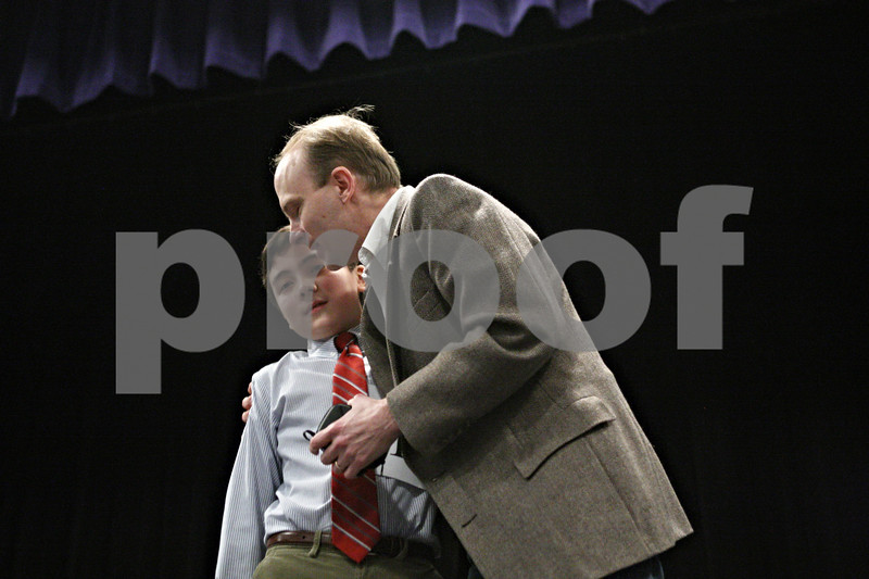 """Rob Winner – rwinner@daily-chronicle.com<br /> <br /> Mark Rogers, 12, who won the DeKalb County Spelling Bee, which was held at Kishwaukee College on Saturday, receives a hug from his father, Paul Rogers. """"It's been a dream of ours since first grade,"""" said Paul Rogers. """"I couldn't be prouder."""""""