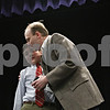 "Rob Winner – rwinner@daily-chronicle.com<br /> <br /> Mark Rogers, 12, who won the DeKalb County Spelling Bee, which was held at Kishwaukee College on Saturday, receives a hug from his father, Paul Rogers. ""It's been a dream of ours since first grade,"" said Paul Rogers. ""I couldn't be prouder."""