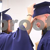 Kyle Bursaw – kbursaw@daily-chronicle.com<br /> <br /> Margaret Murray adjusts Brad Baxter's cap as they wait in a classroom before Hiawatha's graduation ceremony on Friday, May 27, 2011.