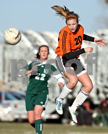 Rob Winner – rwinner@daily-chronicle.com<br /> <br /> DeKalb's Abby Hickey (20) tries to control a ball in front of the Boylan goal during the first half in DeKalb, Ill., on Monday, March 28, 2011. Boylan defeated DeKalb, 3-0.