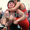 Kyle Bursaw – kbursaw@daily-chronicle.com<br /> <br /> DeKalb's Dylan Hottsmith hoists Ottawa's Jared Jones off the ground<br /> in a 145-pound match during the Northern Illinois Big 12 conference championship at Rochelle high school on Saturday, January  22, 2011