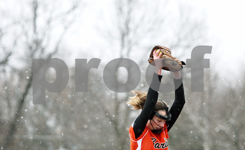 Rob Winner – rwinner@daily-chronicle.com<br /> <br /> As snow begins to fall, DeKalb pitcher Katie Kowalski begins her windup before the final pitch of the game in DeKalb, Ill., on Wednesday, March 23, 2011. DeKalb went on to defeat Indian Creek in five innings, 16-4.