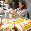Kyle Bursaw – kbursaw@daily-chronicle.com<br /> <br /> Ronda Toepper bags up portions of bread in the kitchen of the Voluntary Action Center in Sycamore, Ill. on Wednesday, June 1, 2011.