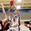 Rob Winner – rwinner@daily-chronicle.com<br /> <br /> Genoa-Kingston's Bret Lucca takes a shot during the first quarter in Genoa, Ill. on Tuesday, Jan. 11, 2011. The Cogs went on to defeat the Cardinals, 49-44.