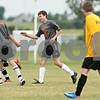 Rob Winner – rwinner@daily-chronicle.com<br /> <br /> Logan Brown (center) is congratulated after scoring DeKalb's second goal while facing Sycamore on Saturday afternoon during the DeKalb Summer Classic at Huntley Middle School in DeKalb.