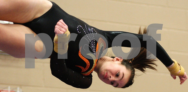 Kyle Bursaw – kbursaw@shawmedia.com<br /> <br /> Caitlyn Nottingham eyes her landing while competing in the vault competition at DeKalb High School on Friday, Dec. 9, 2011.