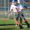 Kyle Bursaw – kbursaw@daily-chronicle.com<br /> <br /> Genoa-Kingston player Russell Heibel chases down a loose ball during a fumble recovery drill at practice on Thursday, Aug. 11, 2011.