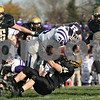Rob Winner – rwinner@shawmedia.com<br /> <br /> Rochelle's Marquez Felix plows into Sycamore's Zach Munro as the Hubs run down the clock late in the fourth quarter of a Class 5A playoff game in Sycamore, Ill., on Saturday, Nov. 5, 2011. Rochelle defeated Sycamore, 21-16.