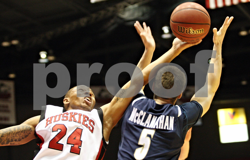 Rob Winner – rwinner@daily-chronicle.com<br /> <br /> Northern Illinois guard Jeremy Landers (24) and Akron guard Brett McLanahan (5) go up for a rebound under the Huskies' basket during the first half in DeKalb, Ill., on Wednesday, Jan. 26, 2011.