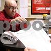 Kyle Bursaw – kbursaw@daily-chronicle.com<br /> <br /> John Saponari hands off a 1040 form to Bjarne 'Bob' Christensen at Jackson Hewitt Tax Service in DeKalb, Ill. on Thursday, Feb. 17, 2011.