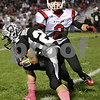 Rob Winner – rwinner@shawmedia.com<br /> <br /> Kaneland receiver Quinn Buschbacher (22) catches a ball ahead of Yorkville's Ilir Emini (2) and then runs for his first of three touchdowns in the first quarter in Maple Park, Ill., on Friday, Oct. 7, 2011.