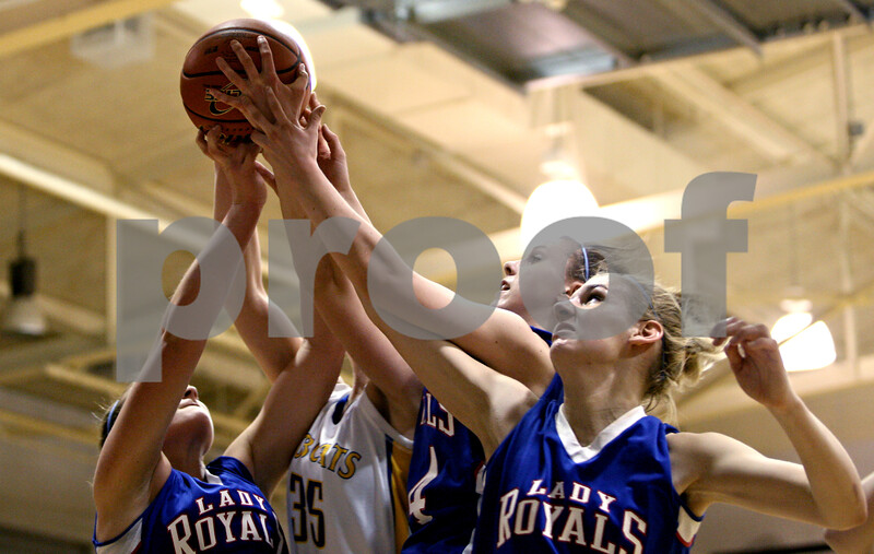 Rob Winner – rwinner@daily-chronicle.com<br /> <br /> Hinckley-Big Rock's Katie Hollis (from left), Somonauk's Lauren Brummel, H-BR's Kaitlin Phillips and Tess Godhardt try to control a ball under the Lady Royals' basket during the second quarter of the IHSA Class 1A Sectional game in Hinckley, Ill., on Monday February 14, 2011.