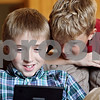 Rob Winner – rwinner@shawmedia.com<br /> <br /> Seth Weeks (left), 9, plays with a portable gaming system as his brother Ethan, 8, watches at their home in Sandwich on Wednesday, Aug. 31, 2011. Seth Weeks was born on September 11, 2001 at Kishwaukee Community Hospital in DeKalb.