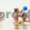 Rob Winner – rwinner@daily-chronicle.com<br /> <br /> (From left to right) Hanna Bastian, 4, of Davis Junction, and Kelli Duprey, of Sycamore, watch as Taylor Fabish, 7, of Byron, dumps a bucket of water over the head of Amy Cappel, of Sycamore, while the four stayed cool at Sycamore RV Resort on Monday afternoon.