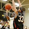 Rob Winner – rwinner@daily-chronicle.com<br /> <br /> Sycamore's Rashaud Bomar (left) tries to get a shot up over DeKalb's Andre Harris during the second quarter in Sycamore, Ill. on Friday, Feb. 25, 2011. DeKalb defeated Sycamore, 56-42.