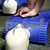 Rob Winner – rwinner@daily-chronicle.com<br /> <br /> A student practices chest compressions on an adult manikin during a CPR class at Community Coordinated Child Care in DeKalb on Monday evening.