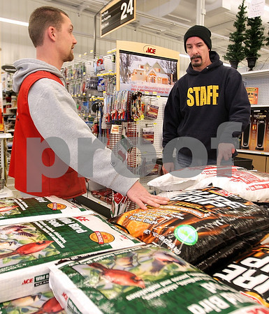 Kyle Bursaw – kbursaw@daily-chronicle.com<br /> <br /> Donnie Lawrence, a sales associate at Ace Hardware, helps Genoa resident Pat McGaughan select the right bag of salt at Tobinson's Ace Hardware in Genoa, Ill. on Tuesday, Feb. 1, 2011.