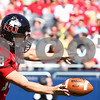 Kyle Bursaw – kbursaw@shawmedia.com<br /> <br /> Ryan Neir (18) punts for the Huskies during the first half of their game against Wisconsin at Soldier Field in Chicago, Ill. on  Saturday, September 17, 2011.
