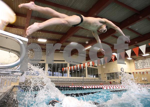 Kyle Bursaw – kbursaw@daily-chronicle.com<br /> <br /> Swimmer Kei Ishimaru dives off the starting block at DeKalb high school during practice on Thursday, Feb. 24, 2011.
