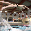 Kyle Bursaw – kbursaw@daily-chronicle.com<br /> <br /> Swimmer Kei Ishimaru dives off the starting block at DeKalb high school during practice on Thursday, Feb. 24, 2011.