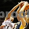 Rob Winner – rwinner@daily-chronicle.com<br /> <br /> Northern Illinois forward Kim Davis (24) and Toledo's Haylie Linn (35) try to control a rebound under the Huskies' basket during the first half on Saturday, Feb. 26, 2011 in DeKalb, Ill.