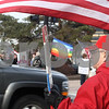 Kyle Bursaw – kbursaw@daily-chronicle.com<br /> <br /> Across the street from the weekly peace vigil in Memorial Park, Frank Beierlotzer stands with a U.S. flag and a sign showing his support for the troops, in DeKalb, Ill. on Friday, March 18, 2011.