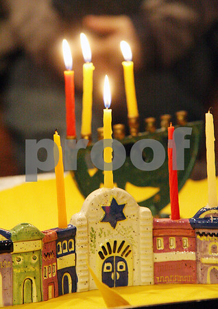 Wendy Kemp - For The Daily Chronicle<br /> Children practiced lighting candles for Hanukkah at Congregation Beth Shalom on Sunday in DeKalb.<br /> DeKalb 12/18/11