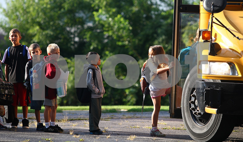Kyle Bursaw – kbursaw@daily-chronicle.com<br /> <br /> Students board a bus at Waterman Elementary headed for Shabbona Elementary on the first day of school Friday, Aug. 12, 2011.