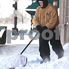 Kyle Bursaw – kbursaw@daily-chronicle.com<br /> <br /> Mark Thompson, owner of Lord Stanley's, shovels out his own business and a few of his neighbor's businesses on Wednesday, Feb. 2, 2011.