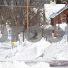 Kyle Bursaw – kbursaw@daily-chronicle.com<br /> <br /> A woman walks in Second street, towards Lincoln Highway on Wednesday, Feb. 2, 2011.