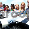 Kyle Bursaw – kbursaw@daily-chronicle.com<br /> <br /> Fourth grade students at Gwendolyn Brooks Elementary School look at a remote controlled airplane owned by Glenn Gates, outside of the school in DeKalb, Ill. on Friday, May 20, 2011.