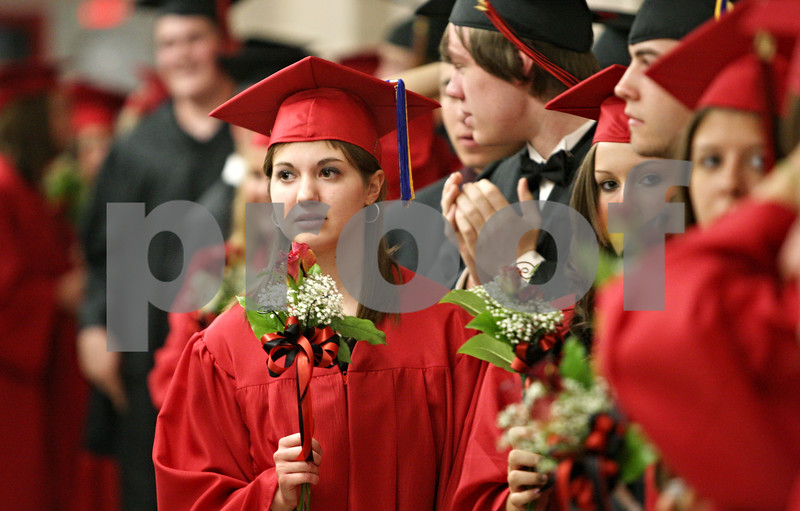 Rob Winner – rwinner@daily-chronicle.com<br /> <br /> Kathleen Chester holds a flower in a hallway outside the gymnasium as graduating seniors line up before the Indian Creek High School commencement on Sunday, May 15, 2011, in Shabbona, Ill.