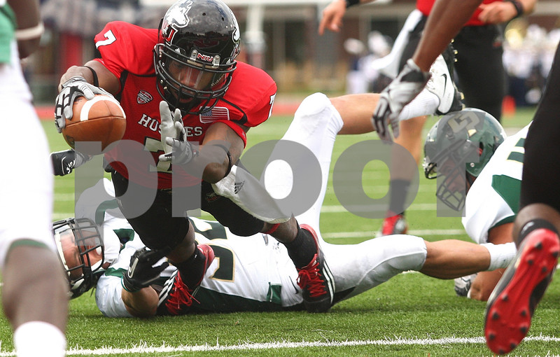 Kyle Bursaw – kbursaw@shawmedia.com<br /> <br /> Northern Illinois wide receiver Perez Ashford (7) extends out for a touchdown during the second quarter of the game against Cal Poly<br /> at Huskie Stadium in DeKalb, Ill. on Saturday, Sept. 24, 2011.
