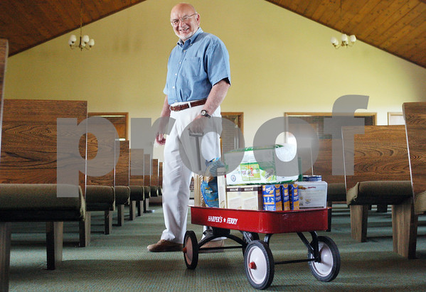 Rob Winner – rwinner@daily-chronicle.com<br /> <br /> Grace Fellowship Church in Maple Park, under Pastor James Harper, Jr., started a red wagon ministry, where members of the church bring groceries and gift cards to fill a red wagon and the pastor gives the donated goods to someone in need.