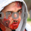 Kyle Bursaw – kbursaw@daily-chronicle.com<br /> <br /> Tom Brown, a junior at NIU, staggers around campus along with several other students in zombie make-up on Saturday, April 16, 2011.